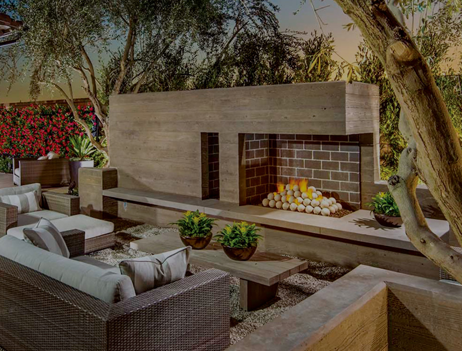 Backyard with outdoor fireplace