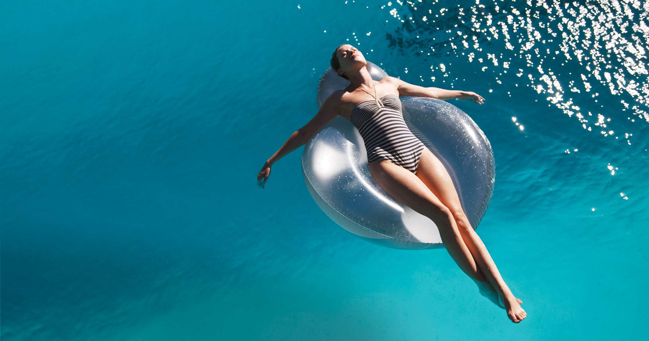 Woman Floating in Pool